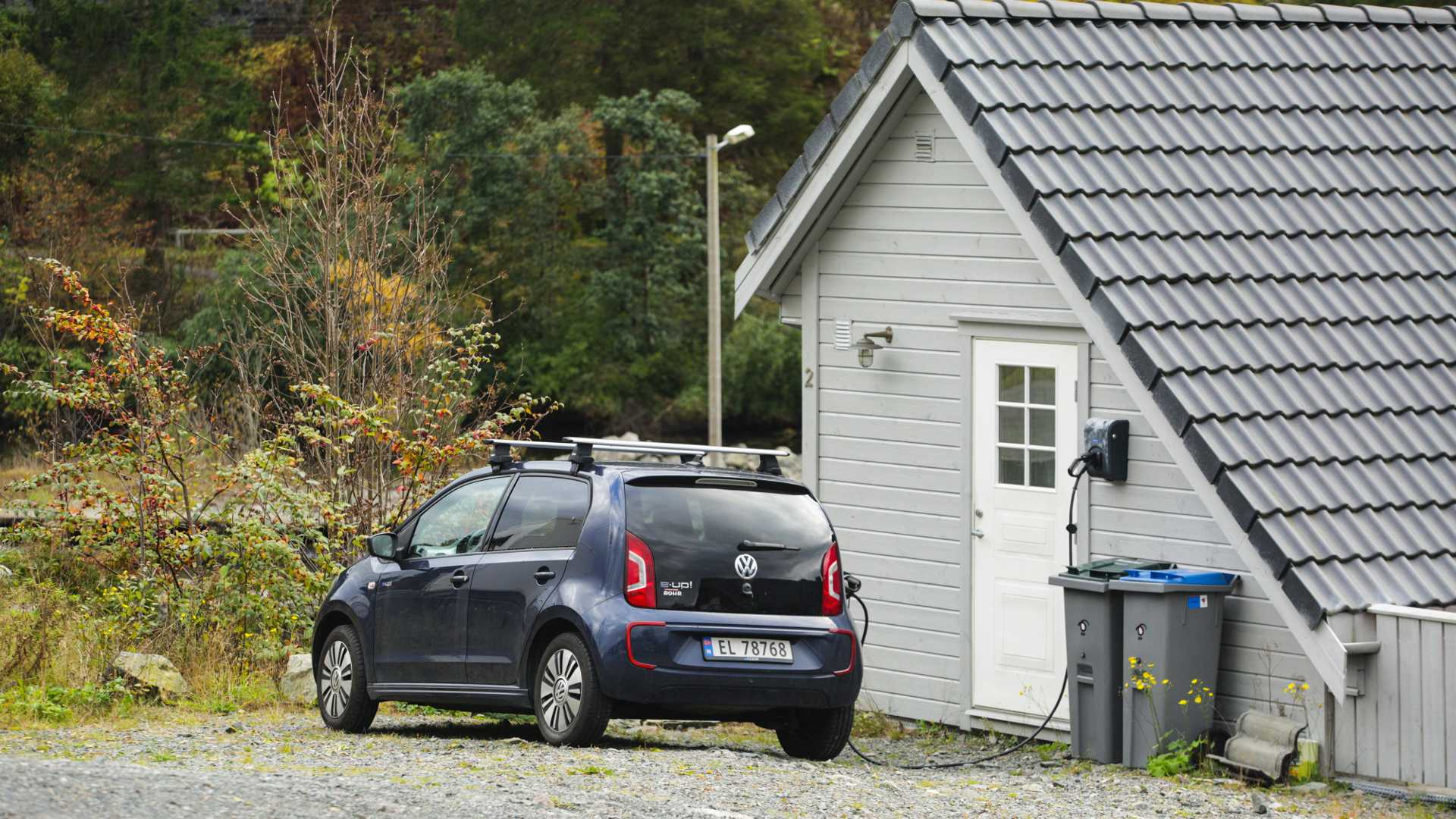 VW E-up at charging station attached to house in Bergen Norway